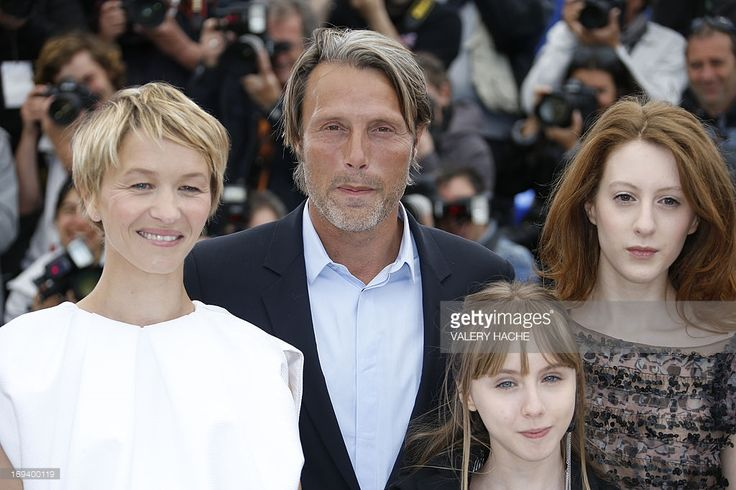French actress Delphine Chuillot, Danish actor Mads Mikkelsen, French actress Melusine Mayance and French-Austrian actress Roxane Duran pose on May 24, 2013 during a photocall for the film 'Michael Kohlhaas' presented in Competition at the 66th edition of the Cannes Film Festival in Cannes. Cannes, one of the world's top film festivals, opened on May 15 and will climax on May 26 with awards selected by a jury headed this year by Hollywood legend Steven Spielberg.