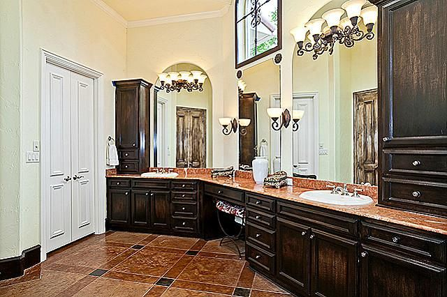 At the left wing of this stunning house plan sits the master suite with an octagonal-shaped trey ceiling, sitting area where the windows peer out, a luxurious master bath with his and hers vanities, separate shower and Jacuzzi tub, bidet, linen closet, and wardrobe with built-ins. – See more at: https://www.thehousedesigners.com/plan/laparelli-9498/ #houseplan #homeplan #homeseach #househunt #dreamhome