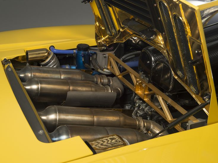 This Brand-New Dandelion Yellow McLaren F1 Still Wears Its Plastic Seat Covers