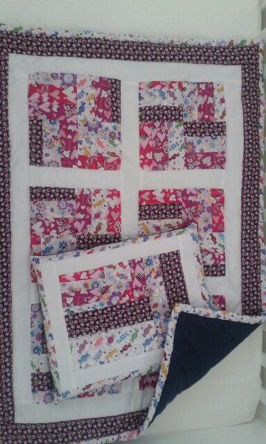 Baby quilt with pillow.