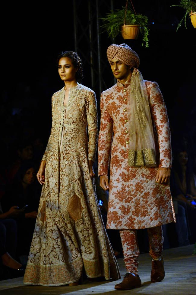 Opium by ace-designer Sabyasachi Mukherjee at the opening night of PCJ Delhi Couture Week 2013. Rose prints were mainly seen on Churidar for Men. #Fashion #India