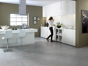 Porcelein tiles look amazing.  I love the look of slate and wanted this to translate into the kitchen but without having to worry about it flaking so gray large tile porcelein is a great option! Will also transition into the dining room.