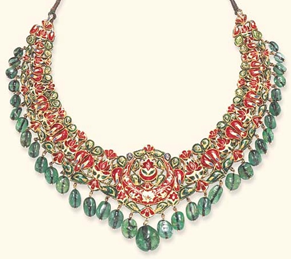 AN INDIAN DIAMOND, EMERALD AND ENAMEL NECKLACE   Designed as an openwork bib set with table-cut diamonds within foiled surrounds, suspending a graduated emerald bead fringe, to the polychrome enameled reverse decorated with red, green and white floral motifs, and adjustable green cord, mounted in gold