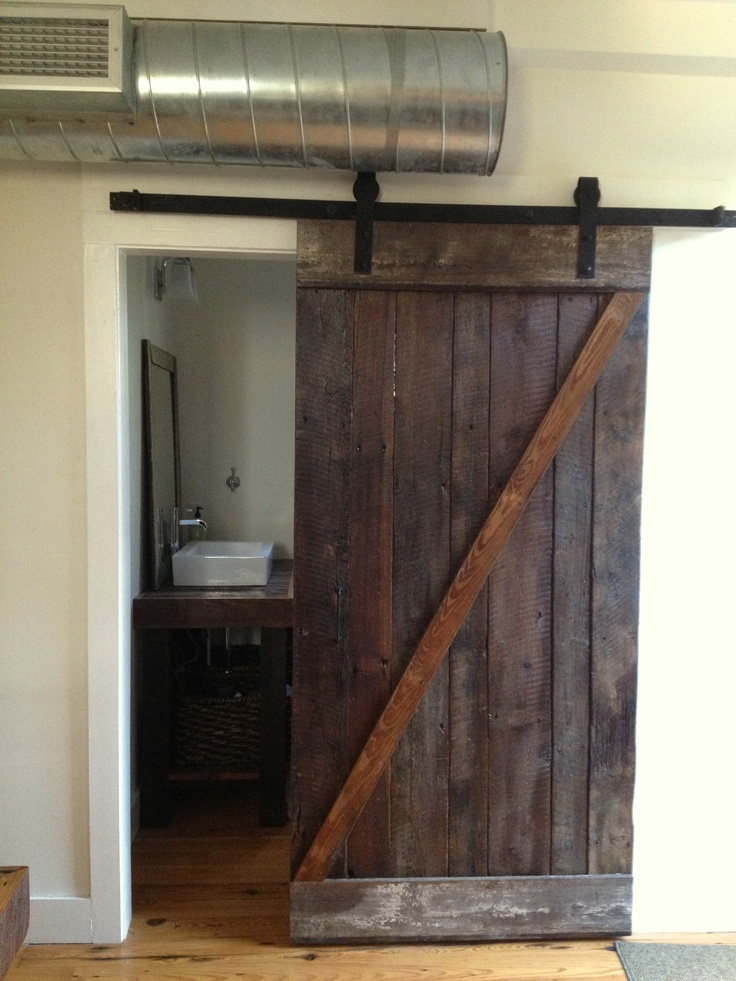 Exposed Ducts Reclaimed historic wood boards for sliding barn door. Space saver for bathroom. & 92 best Ducts and ceilings exposed images on Pinterest | Ac vent ... pezcame.com