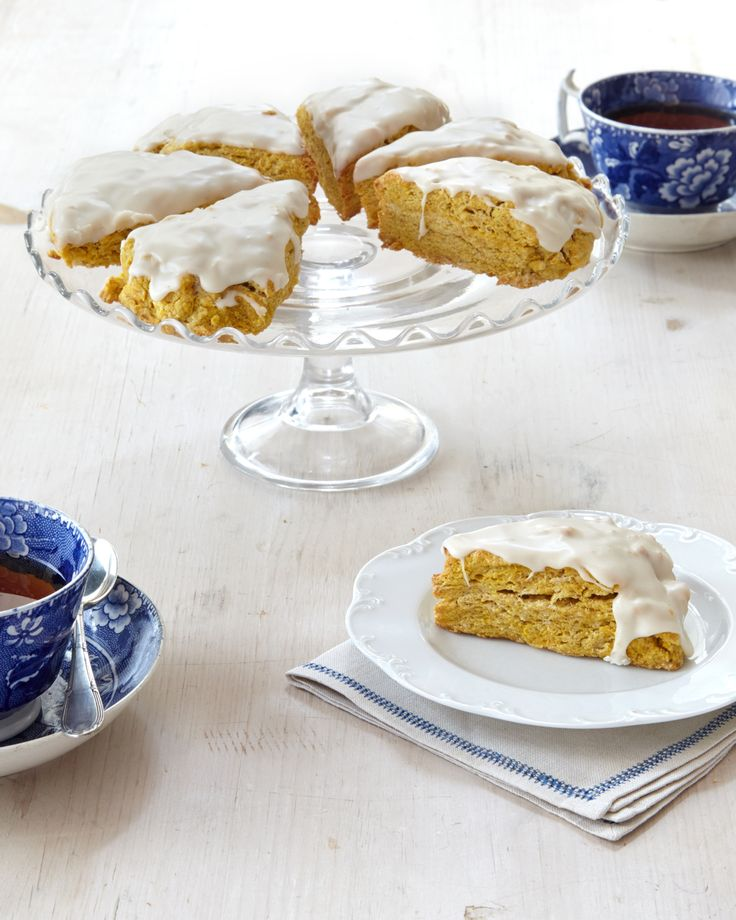 Pumpkin Scones | Martha Stewart Living - These pumpkin-spice scones finished with a maple glaze will be the first to disappear at your next brunch.