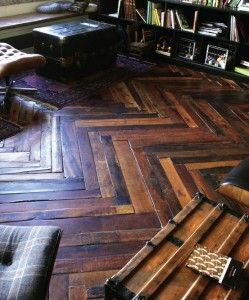 Shipping pallet flooring can be laid in various patterns such as this herringbone design.