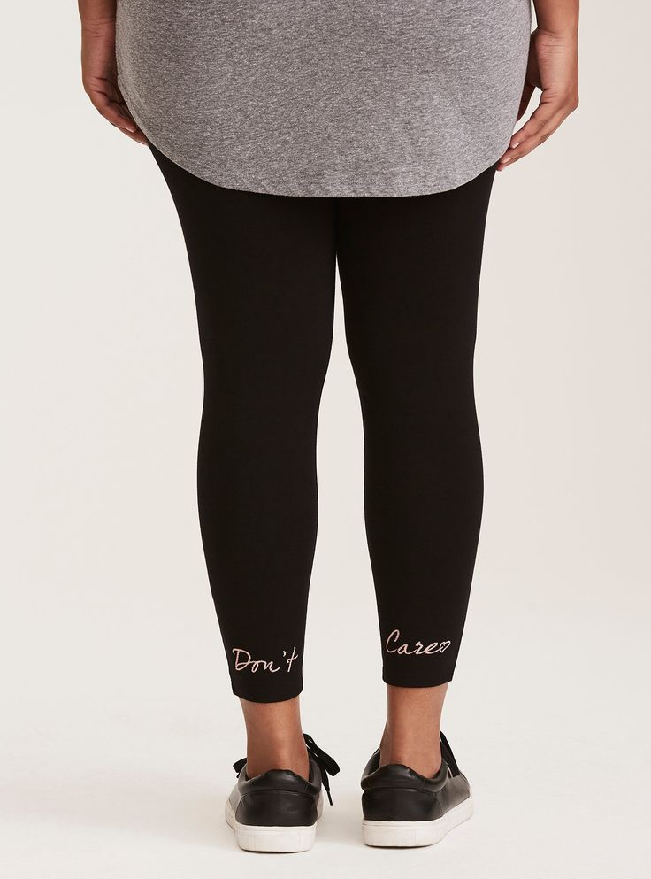 """Next time someone asks for your opinion, simply point them to the back of these cropped leggings: """"don't care."""" The pink embroidery highlights the black knit, adding a pop of color. The knit is super stretchy, with a thick tummy-smoothing waistband.   High waisted  25"""" inseam  Cotton/spandex  Wash cold, dry low  Imported plus size leggings"""