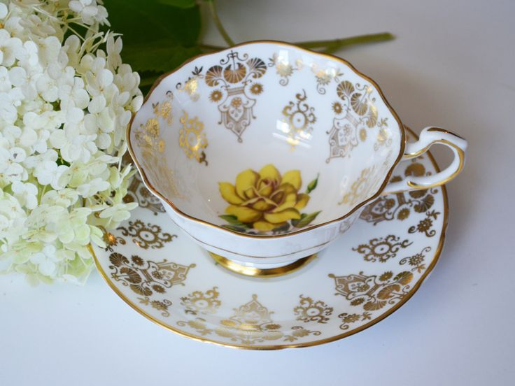 Paragon Tea Cup, Ivory with Yellow Rose and Gold Gilt Bone China Teacup and Saucer, Hand numbered, Made in England by Trashtiques on Etsy https://www.etsy.com/ca/listing/552295279/paragon-tea-cup-ivory-with-yellow-rose