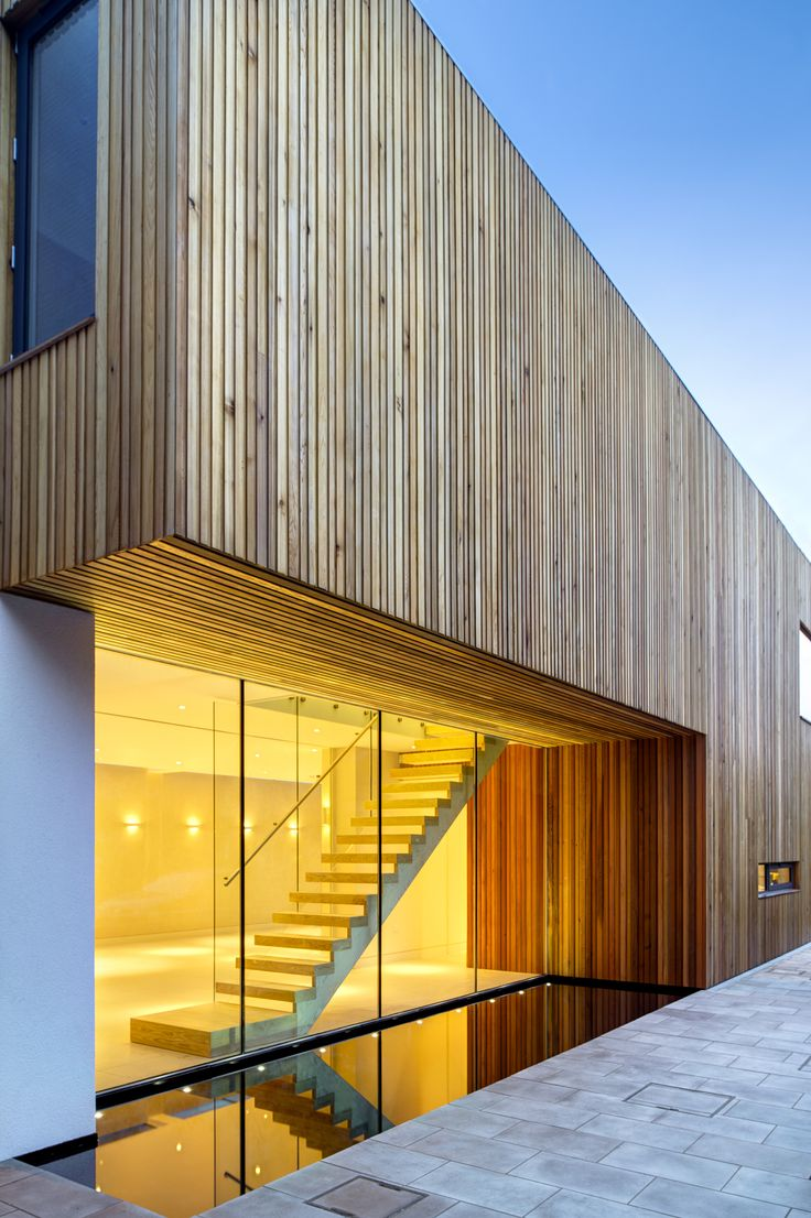 The reflection pool, western red cedar cladding & frameless glass play with…