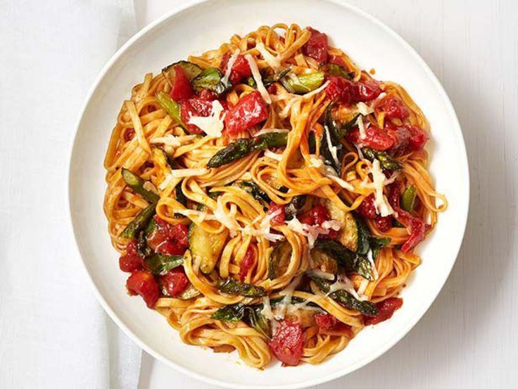 Roasted Vegetable Pasta : Roast zucchini and asparagus in the oven until tender before tossing together with fresh linguine and an easy tomato sauce.