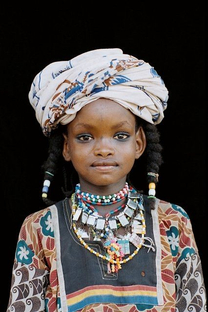 Young Wodaabe girl. he Wodaabes are a Nomadic clan scattered across the Sahel belonging to the Fulani ethnic group. The majority of the Wodaabes can be found in Niger republic - followed by neighbouring Northern Nigeria