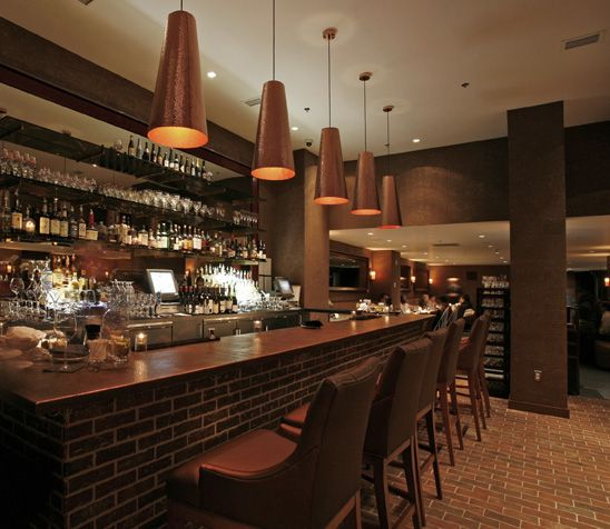 This is a floor and bar at the Lorien Hotel and Spa, in Alexandria, VA. . The King Street tiles are on the floor, and the Lancaster Running Bond are on the wall. It is the Providence color mix.