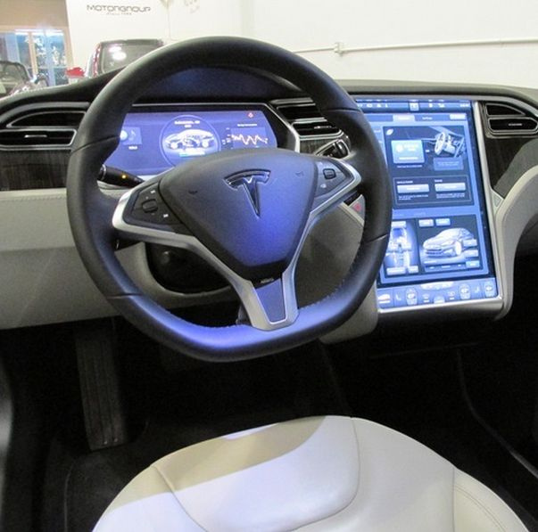 Futuristic interior with high tech gadgets. This can only be the Tesla Model S. Click the link for more cool pics #spon