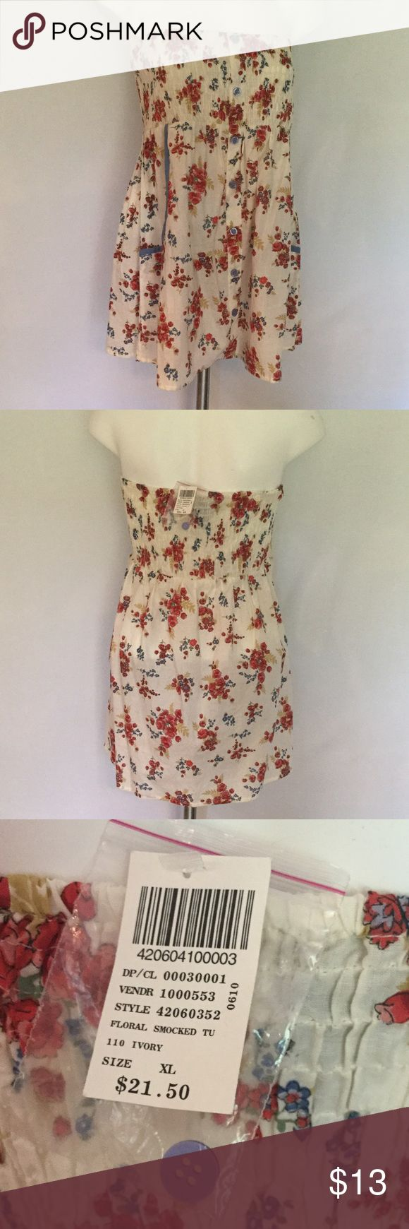 Wet Seal Floral Smock Top 🍂 Wet Seal top in baby doll smock top style. Elastic top with flowy bottom. Two side accent pockets. NWT Size XL red, pink, blue, tan, green and white background Wet Seal Tops