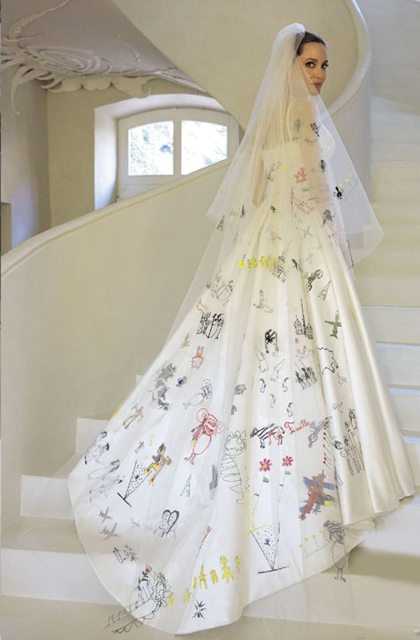 This shows that she's a devoted mother to her kids to have their personal drawings on her bridal veil!