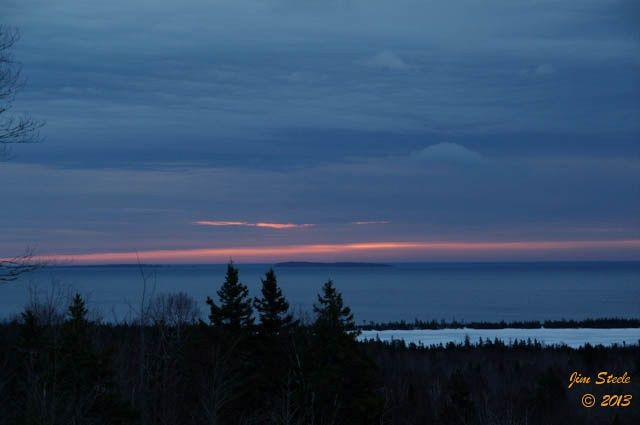 The sun tries to break through the clouds during the morning sunrise in Cape Breton.