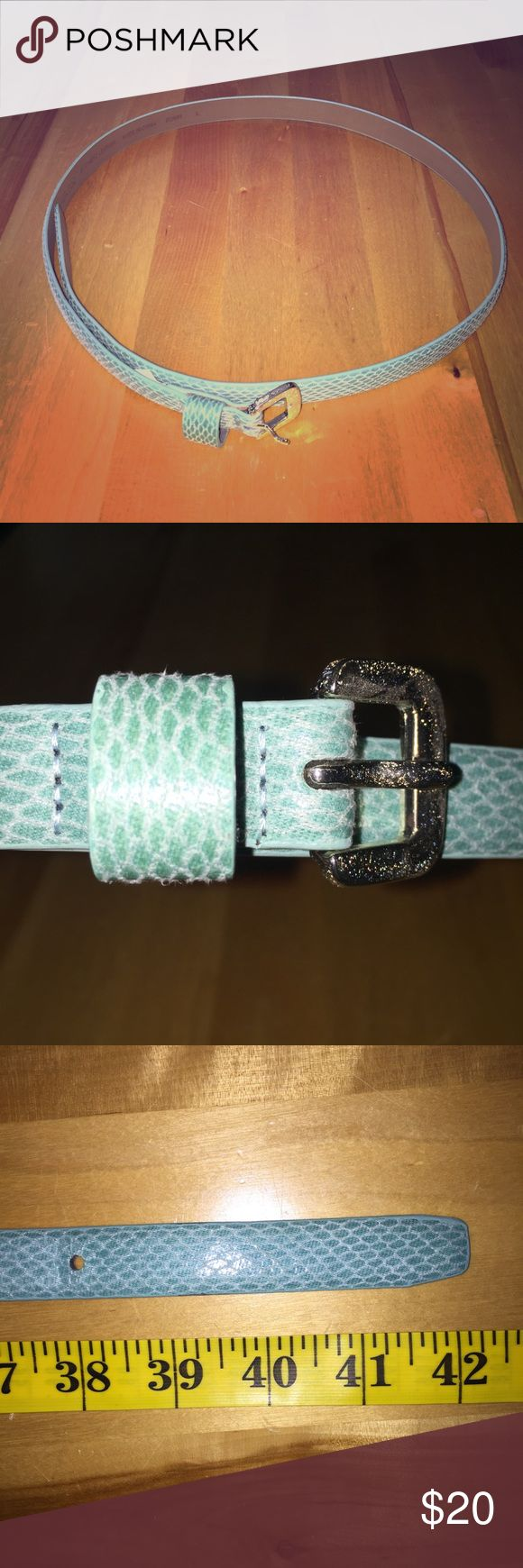 Banana Republic Mint Faux Leather Belt, Size L This mint / turquoise Faux leather skinny belt can pair with jeans or a dress for a quick splash of color! Feeling that LBD but want some quick outfit TLC? This piece is to the rescue! 🍀 Banana Republic Accessories Belts