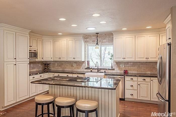 Traditional Kitchen with Raised panel, Limestone Tile, Farmhouse sink, U-shaped, Kitchen island, High ceiling, Breakfast bar