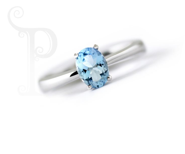 Handmade 9ct White Gold Ring Set With a Rectangular Cushion Cut Sky Blue Topaz