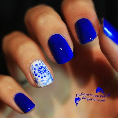 Inspirational photo by Chan Fie. The theme for these nails was meant to be China Porcelain. I ended up doing flowers a little more cutesy than oriental... but I still love them :) The blue is Essie bouncer it's me.