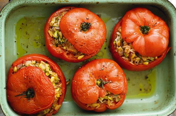 This mouth-watering Moroccan rice-stuffed tomatoe recipe is a healthy vegetarian option for lunch or dinner. These delicious tomato parcel are packed with a rice, red onion, pine nuts and spiced stuffing which is bursting with flavour. One tomato not only works out as 1 of your 5-a-day, it's also only 211 calories - perfect if you're calorie counting.