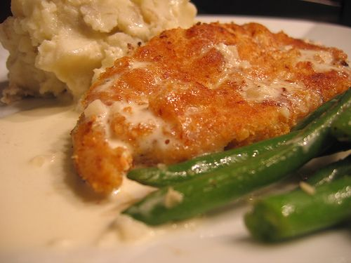 Crispy Chicken Costoletta, like Cheesecake Factory. Breaded chicken with a creamy lemon garlic sauce.