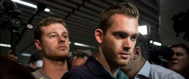 PHOTO: U.S Olympic swimmers Gunnar Bentz and Jack Conger leave the police…