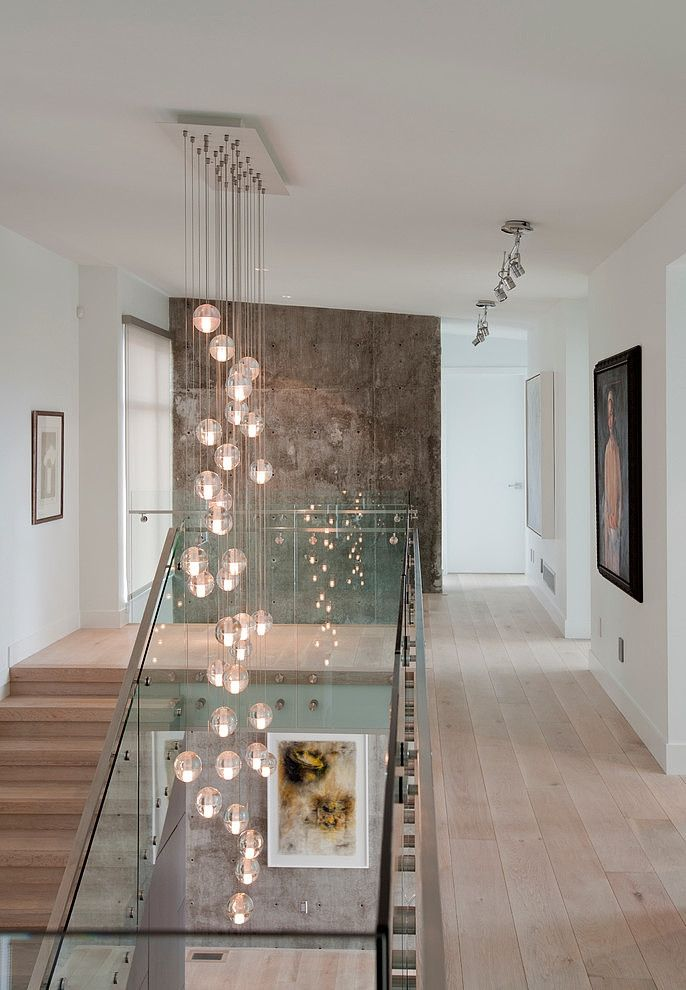 great space for displaying art love the cascading glass light fixture design by tanya - Home Design Lighting