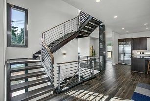 Contemporary Staircase with Hardwood floors, High ceiling