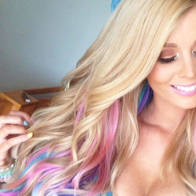 long blonde hair with pink purple teal peek a boo