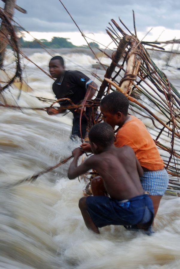 "500px / Photo ""Fishing the Congo"" by Mikael Strandberg"
