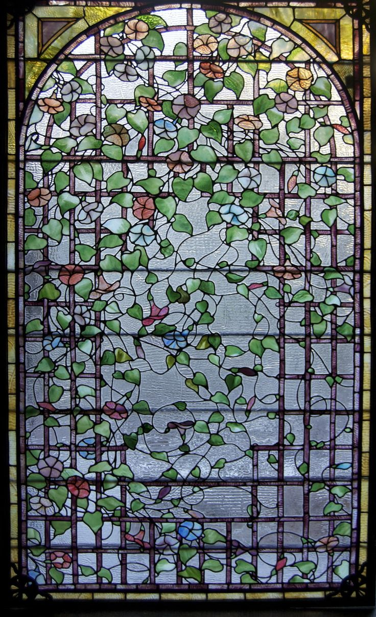 A wonderful Antique American Stained Glass Morning Glory Trellis Window.