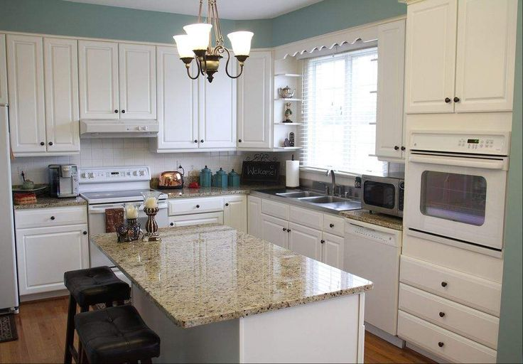 Kitchens with white appliances white cabinets and for Kitchen designs with white appliances