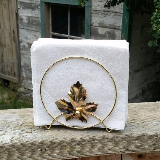 Check out this item in my Etsy shop https://www.etsy.com/ca/listing/457914322/midcentury-wire-napkin-holder-gold-tone