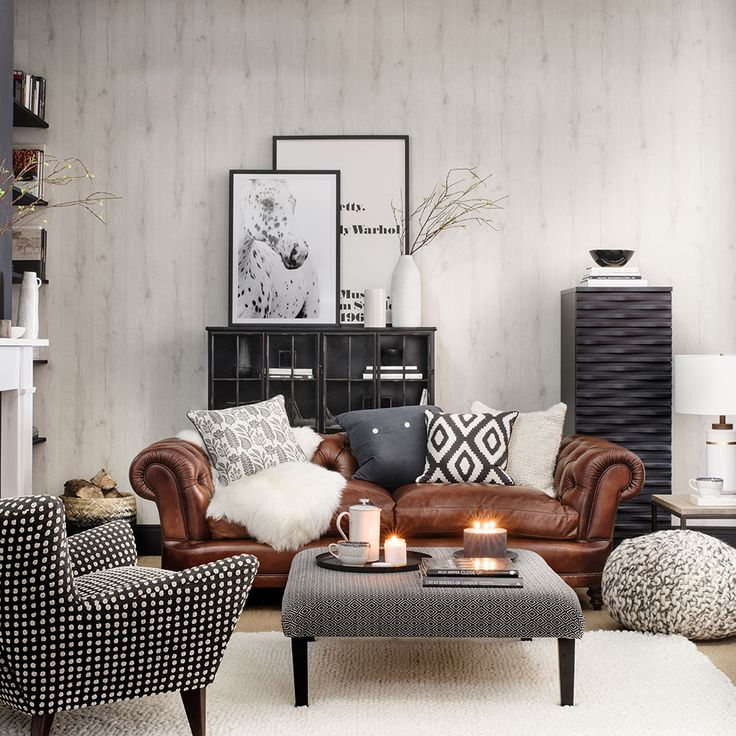 A traditional Chesterfield-style sofa can work brilliantly in a contemporary Scandi scheme. Alongside sleek, modern and mid-century-inspired pieces, it'll make a room friendlier looking, for a cool-but-comfy spin on rustic style. A wood-effect wallpaper looks more interesting and feels cosier than a plain wall, but is much more subtle than a pattern.