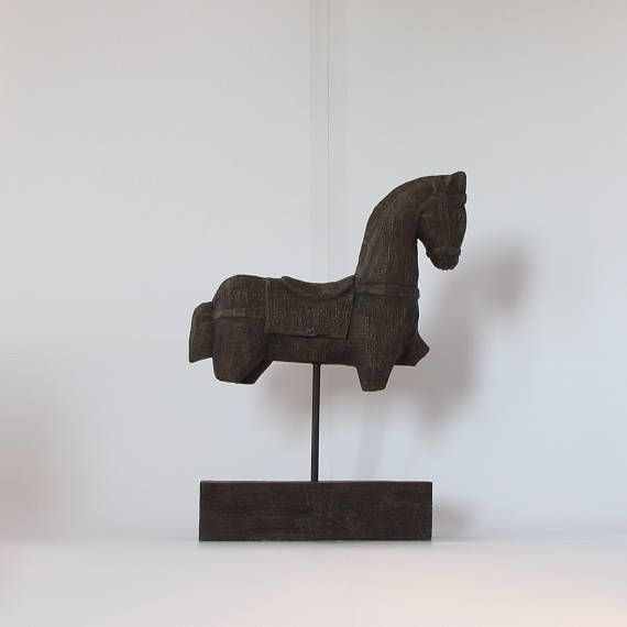 Wood sculptureFigurine.Wooden trojan horse Fragment on