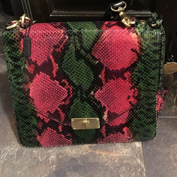 Brahmin handbag snakeskin print Brahmin handbag. Only used a few times. Main compartment and open pocket on back. Colors are mainly pink and green. Purse is in excellent condition. Comes with bag. Brahmin Bags Shoulder Bags