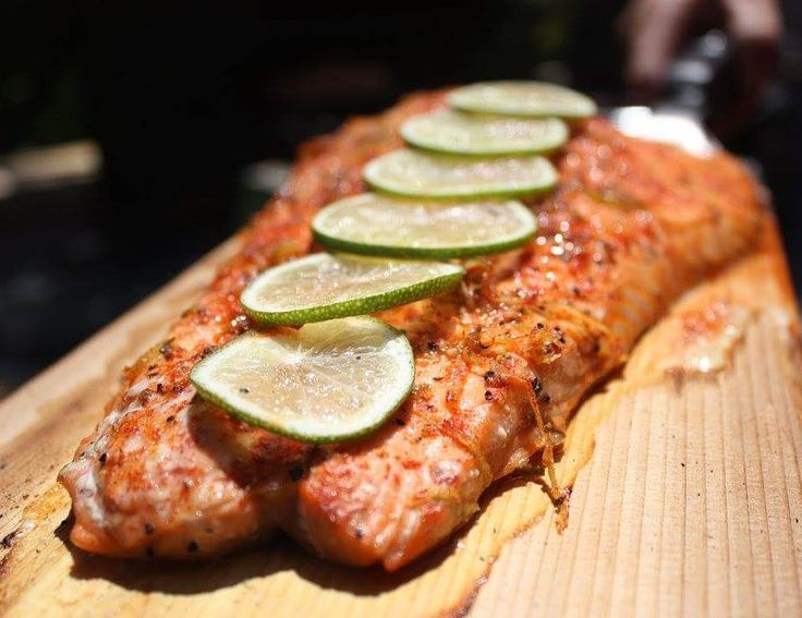 Beautifully Smoked Salmon on a Cedar Plank with a squeeze of lime.