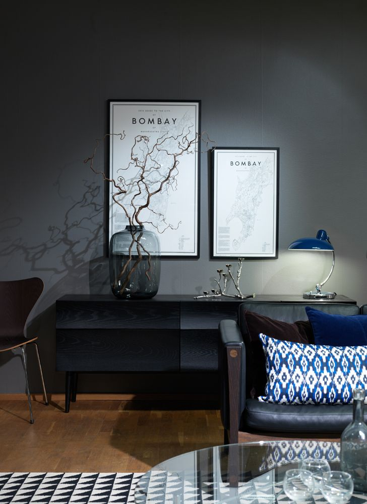 From our store south of Stockholm. On the picture: posters Guide to Bombay  from Ehrenstråhle & Wågnert, Kaiser Idell from Fritz Hansen, Reflect from Muuto, chair series 7 from Fritz Hansen, sofa from Carl Hansen & Søn, carpet from GAN rugs. #design #stockholm #livingroom #carpet #lighting #poster