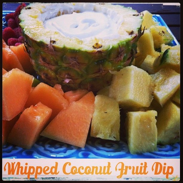 Whipped coconut fruit dip in a pineapple bowl