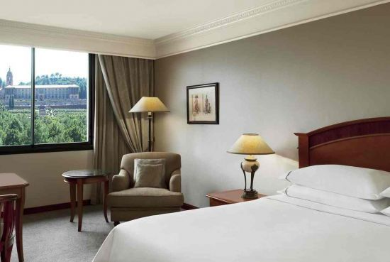 Spacious Deluxe Room  Wifi  Handicap  Sunshine All 10 Deluxe Rooms are larger in its size than the Classic Rooms and feature exquisite wooden floors which compliment the softness of the cream colored furnishings. View More: http://bit.ly/1gTme16 #sheraton #pretoria