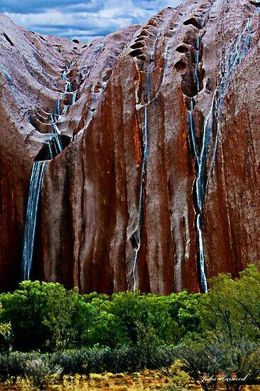 Rain flowing off Uluru - rare event in the Northern Territory, Australia