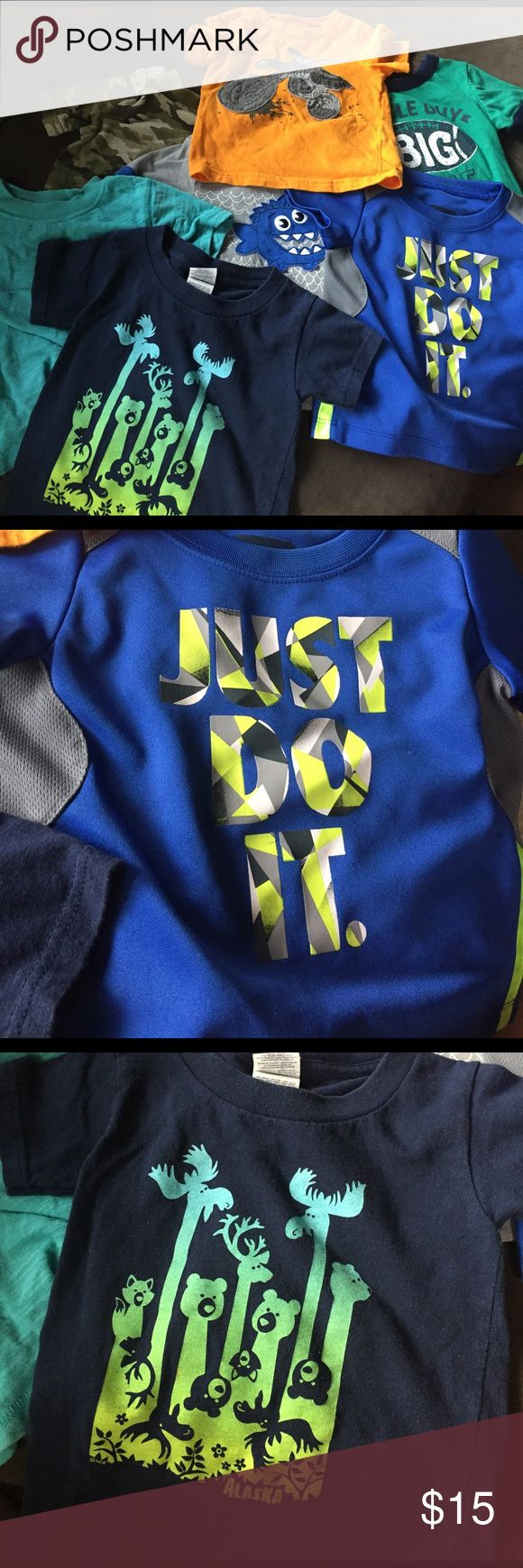 7 toddler Boy t-shirts (12 months) 7 toddler Boy t-shirts (12 months) the light teal shirt is 6-12 months and the navy blue shirt from Alaska is 2T but all the same size. Great condition. No stains. Shirts & Tops Tees - Short Sleeve
