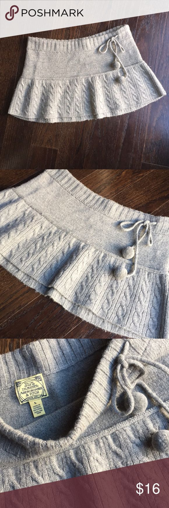 """EUC Abercrombie and Fitch 100% Wool skirt sz. L Adorable grey cable knit Wool skirt Barely worn. No damage or stains. Slightly stretchy with drawstring [poms]  Measures 15"""" across the waist [laid flat] & length is 11.5"""" in front 12.5"""" in back. Abercrombie & Fitch Skirts Circle & Skater"""