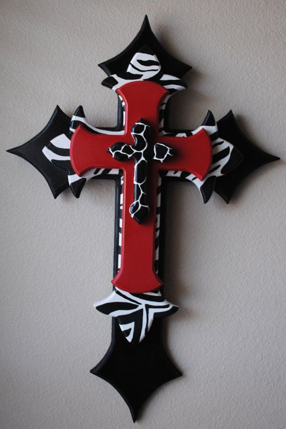 Cool idea...buy different sizes of wooden crosses, paint, then layer them! I love this idea