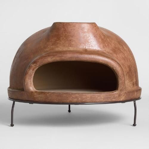 We made an extra-large version of our popular terracotta pizza oven! This wider design makes it easy to cook wood-fired, full-sized artisan pizzas outdoors or inside your home wood oven. Light dry wood at the back of this oven until it reaches around 660 degrees F, then simply keep the fire burning to bake pizza after delicious pizza.