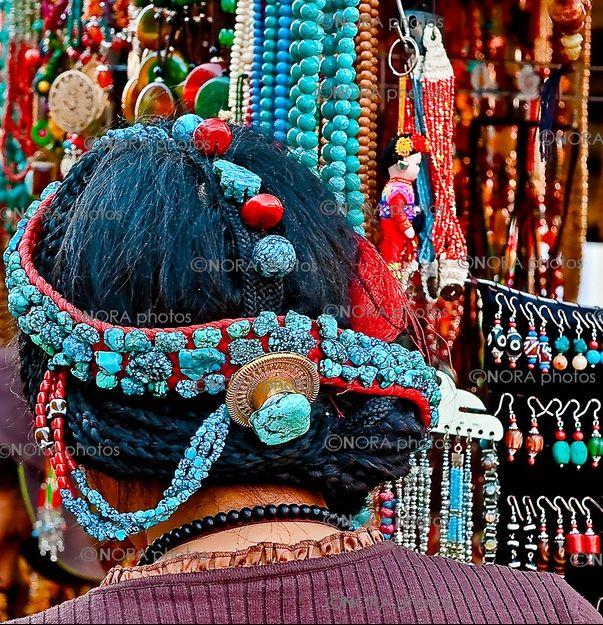 Tibet | Tibetan Women wearing/selling traditional Turquoise Jewelry. Lhasa, | ©Nora de Angelli