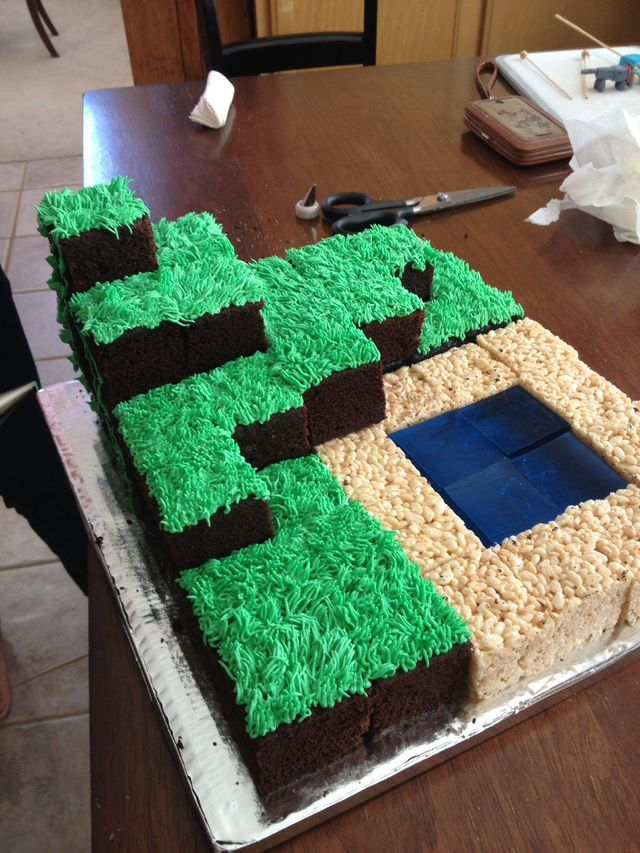 Minecraft cake. 2 boxes chocolate cake mix. Green frosting with grass tip. 1 box blue jello. Rice crispy squares.