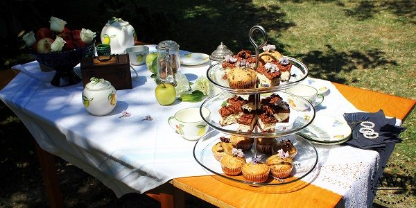 vintage table with muffins and cookies
