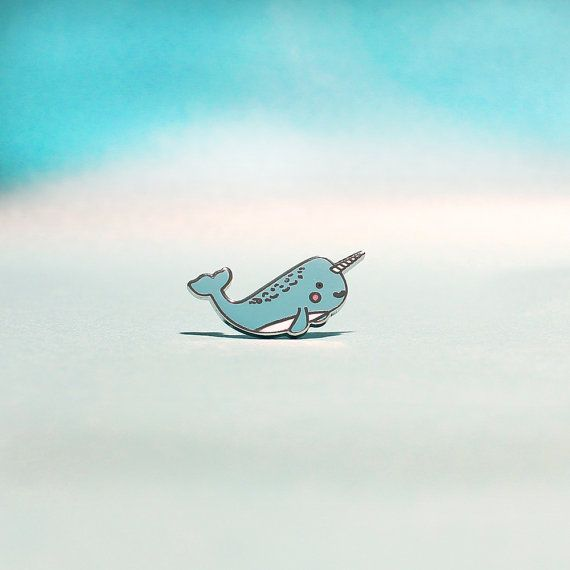 Adorable Narwhal Enamel Pin. - Silver metal detailing - Made from the high quality hard enamel - Comes on a cute ocean scene backing card - Measures 2.5cm x 1.2cm